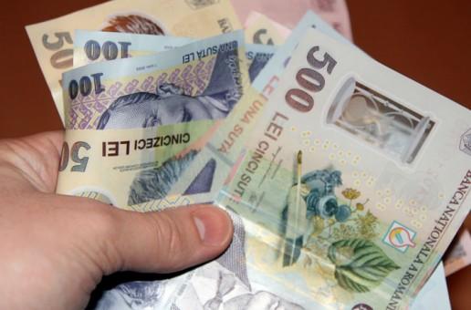 Salariul minim s-ar putea majora la 1.450 de lei