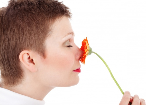 woman_smelling_flowers_198245